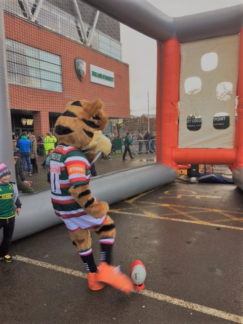 Welford the Leicester Tiger Attempts the Conversion Challenge game at the Family Fun Day